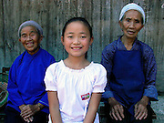 Young Girl and grandparents near Duyun, Guizhou Province, China.