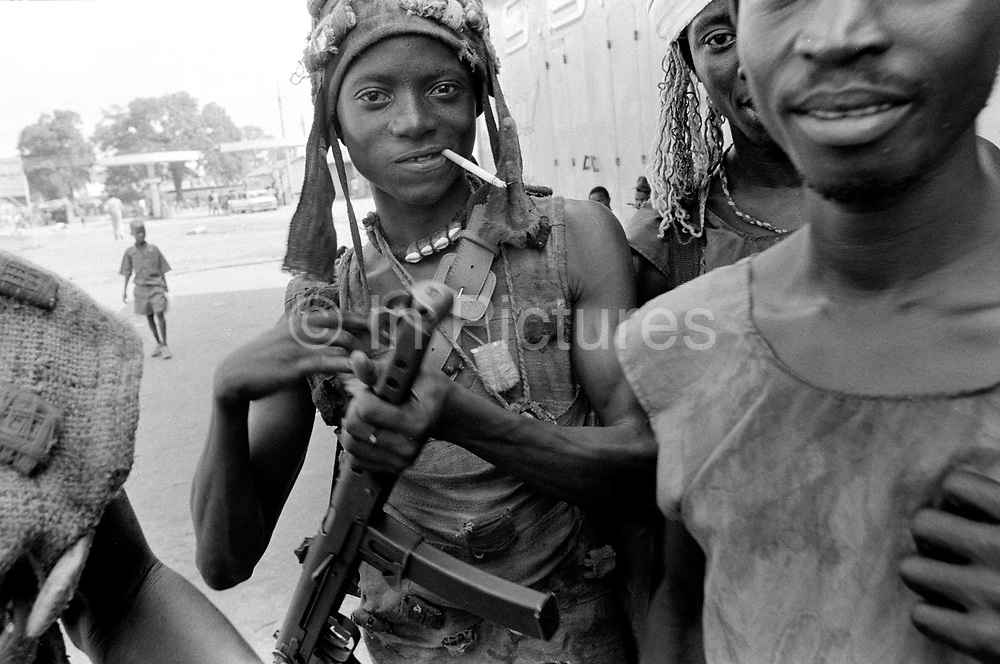 Kamajor Fighters in Bo, Sierra Leone. Kamajors (from the Mende word for 'hunter') were a well armed militia fighting for the government forces aginst the RUF rebels. Linked with witchcraft and secret societies, Kamajors wear talismans and charms believed to protect them in battle