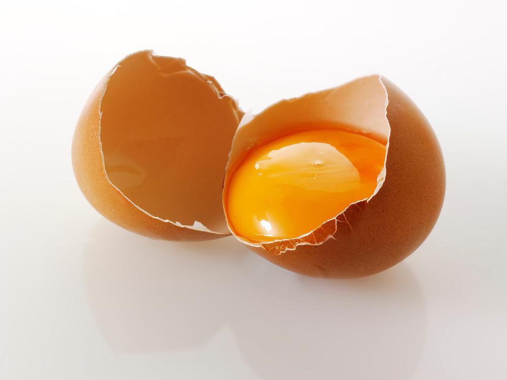 Cracked fresh Burford Brown free range organic Eggs