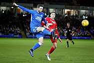 Peterborough Utd defender Jason Naismith (2) clears this ball during the EFL Sky Bet League 1 match between Peterborough United and Scunthorpe United at London Road, Peterborough, England on 1 January 2019.