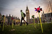 Climate campaign group 10:10 covered Parliament square outside the Houses of Commons with over 1000 whirling pin wheels highlighting public support for onshore wind power on 17th November 2016 in London, United Kingdom. As scientists declare 2016 the hottest year on record, campaigners are calling for government funds to be urgently redirected away from fossil fuels and to the development of clean energy.