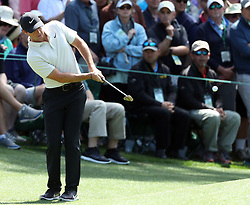 April 6, 2018 - Augusta, GA, USA - Rory Mcllroy chips to the sixth hole green during the second round of the Masters Tournament Friday, April 6, 2018, at Augusta National Golf Club on Friday, April 6, 2018, in Augusta, Ga. (Credit Image: © Jason Getz/TNS via ZUMA Wire)
