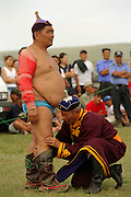 Khui Doloon Khudag, Mongolia, July 2003..Competitors and spectators at the Mongolian Wrestling contests in the national Naadam.