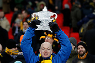 a Newport fan holds up a foil home made replica of the FA Cup Trophy. The Emirates FA Cup, 4th round replay match, Tottenham Hotspur v Newport County at Wembley Stadium in London on Wednesday 7th February 2018.<br /> pic by Steffan Bowen, Andrew Orchard sports photography.