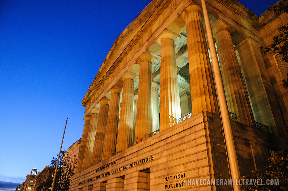 Exterior of the Smithsonian David W. Reynolds Center for American Art and Portraiture in downtown Washington DC at dusk.