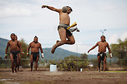 SAN MARTIN DE LAS PIRAMIDES, MEXICO - APRIL 15, 2017: A player hits with her hips a rubber ball, seven pounds weight, during a tourney of Mesoamerican Ball Game titled Ulamaztli. A player prepares himself to receive and hit a rubber ball during a tourney of Mesoamerican Ball Game titled Ulamaztli. To withstand the blow of the ball, that weighs 7 pounds, the players protect their hips with bandages and leather belts. Each team has 5 players and the game purpose is to keep the ball inside the play area without touch it with hands or another part of the body, except the hips. Rodrigo Cruz for The New York Times
