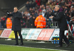 """Swansea City manager Carlos Carvalhal (left) and West Ham United manager David Moyes gesture on the touchline during the Premier League match at the Liberty Stadium, Swansea. PRESS ASSOCIATION Photo. Picture date: Saturday March 3, 2018. See PA story SOCCER Swansea. Photo credit should read: Nick Potts/PA Wire. RESTRICTIONS: EDITORIAL USE ONLY No use with unauthorised audio, video, data, fixture lists, club/league logos or """"live"""" services. Online in-match use limited to 75 images, no video emulation. No use in betting, games or single club/league/player publications."""