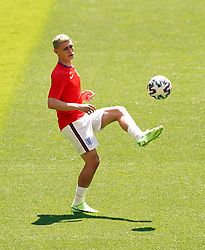England's Phil Foden warms up on the pitch before the UEFA Euro 2020 Group D match at Wembley Stadium, London. Picture date: Sunday June 13, 2021.