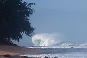 A huge North Shore wave pummels the shore.