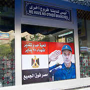 A poster on the window of Koshary Abou Tarek shows General Sami Anan as he announced Mubarek's departure from office. Cairo, Egypt.