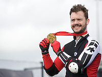 Blue Peter presenters have gone head-to-head on their personally modified bikes in a cycle race for Sport Relief 2014.  Barney Harwood poses with his gold medal for winning the race<br /> <br /> Photo by Chris Vaughan/CameraSport<br /> <br /> Commercial - Sport Relief -  publicity shoot - Tuesday 4th March 2014 - University of Central Lancashire Sports Arena - Preston<br /> <br /> © CameraSport - 43 Linden Ave. Countesthorpe. Leicester. England. LE8 5PG - Tel: +44 (0) 116 277 4147 - admin@camerasport.com - www.camerasport.com