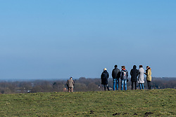Spectators look down across the hills for a glimpse of the race approaching  - Drentse 8, a 140km road race starting and finishing in Dwingeloo, on March 13, 2016 in Drenthe, Netherlands.