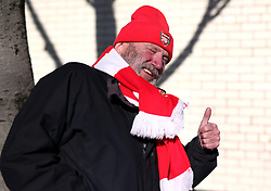 Arsenals fan arriving at the ground before the game