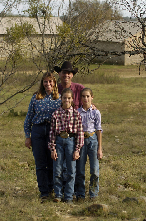Brownwood, Texas November, 2004:  The Richard Jordan ranching family of Brooke Smith, TX in rural Brown County, TX. Family members are Richard Jordan, Marie Jordan and twin daughters Casey (in purple shirt) and Kelsey.  The Jordans are full-time cattle ranchers,  part of a shrinking number of Texas family ranchers.  Photos by Bob Daemmrich <br /> All Models Released OK OK <br /> ©Bob Daemmrich  /