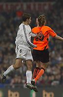 15/2/2004 Madrid, Spain.<br />La Liga (Spanish League), stage 24.<br />R.Madrid 1 - Valencia 1<br />R.Madrid's Helguera in duel with Valencia's Mista at Santiago Bernabeu's Stadium.<br />© 2004 Alejandro leon Fernandez