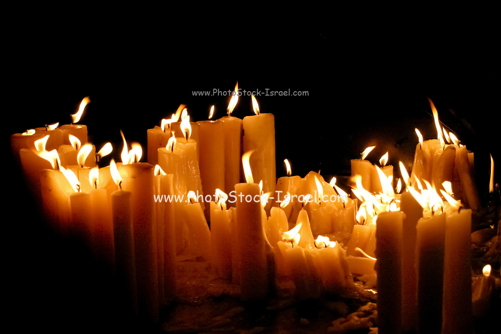 lit prayer candles in a dark church Photographed in Zagreb, Croatia
