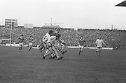 Dublin is outnumbered by Kerry as they all attempt to grab the ball during the All Ireland Senior Gaelic Football Final, Kerry v Dublin in Croke Park on the 28th September 1975. Kerry 2-12 Dublin 0-11.