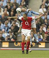 Photo. Aidan Ellis.<br />Manchester City v Arsenal.<br />Barclays Premiership.<br />25/09/2004.<br />Manchester's Antoine Sibierski and Arsenal's Dennis Bergkamp