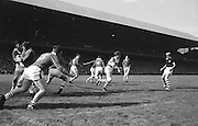 Cork goalie Billy Morgan weaves his way through his backs during the All Ireland Senior Gaelic Football Final Cork v. Meath in Croke Park on the 24th September 1967.