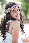 Young smiling teen with flowers in her hair