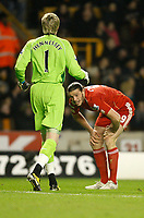 20120131: WOLVERHAMPTON, UK - Barclays Premier League 2011/2012: Wolverhampton Wanderers vs Liverpool.<br /> In photo: Wolverhampton Wanderers goalkeeper Wayne Hennessey checks on the well being of Liverpool's Andy Carroll.<br /> PHOTO: CITYFILES