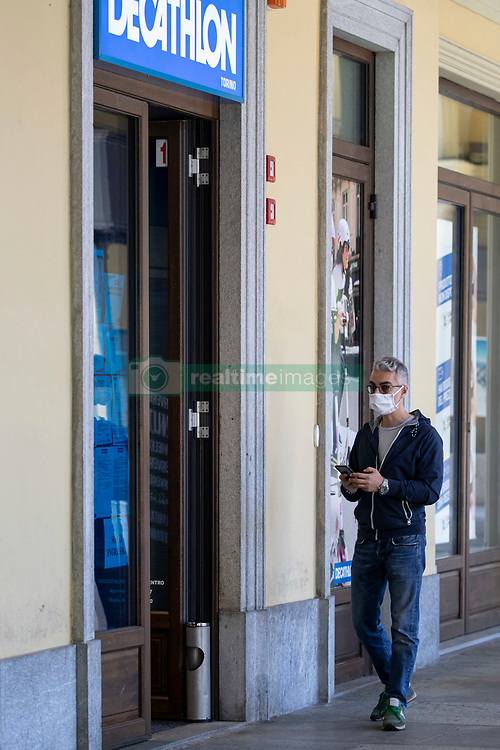 After the end of the quarantine in Italy some commercial activities are reopened, with the workers observing the security measures, Turin (Italy) on May 4, 2020. Photo by Marco Piovanotto/ABACAPRESS.COM