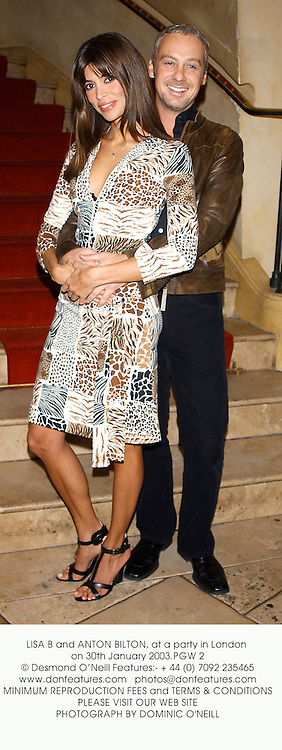 LISA B and ANTON BILTON, at a party in London on 30th January 2003.PGW 2