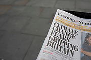 Climate change headline on the Evening Standard newspaper in London, England, United Kingdom.