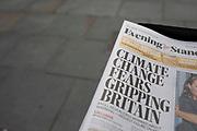 Climate change headline on the Evening Standard newspaper in London, England, United Kingdom.