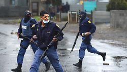 SOUTH AFRICA - Cape Town - 9 July  2020  - Police used live ammunition and fired rubber bullets as they were retreating from  protesting Mfuleni residents and backyarders who were  the Hindle Road.They burnt tyres and rubble and blocked the road with bricks and rocks. Picture: Phando Jikelo/African News Agency(ANA)