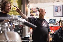 "Bill Dodge at his ""Blings Cycles"" custom shop while friends meet up and work on their bikes after a long day at Daytona Beach Bike Week 2015. FL, USA. Monday March 9, 2015.  Photography ©2015 Michael Lichter."