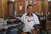 August 2012: Kelabit native, Headman/Chief Jangin Taibilung of both Long Napir and Long Seboyan communities. He is one of the old survivors, many of the other respected elders and fighters for the forest have since passed away. Long Seboyan, Limbang district, Sarawak, Borneo <br /> <br /> Kelabit native people facing a mounting threat to lose their traditional lands, ancestral burial grounds, culture and habitat, once the hydro-electric dam project floods their lands. Limbang, Sarawak Borneo..The Limbang valley including Long Napir, a cluster of four settlements of Penan and Kelabit people, is threatened by a new hydro-electric project which will flood the entire area, displacing thousands of native people. The Murum Hydro-electric project already underway affecting the Rejang region, will displace over 24,000 Dayak native residents, destroying their longhouses and forest habitat. The dam site is located on the Murum River, in the uppermost part of the Rajang River basin, 200km from Bintulu. Sarawak's primary rainforests have been systematically logged over decades, threatening the sustainable lifestyle of its indigenous peoples who relied on nomadic hunter-gathering and rotational slash & burn cultivation of small areas of forest to survive. Now only a few areas of pristine rainforest remain; for the Dayaks and Penan this spells disaster, a rapidly disappearing way of life, forced re-settlement, many becoming wage-slaves. Large and medium size tree trunks have been sawn down and dragged out by bulldozers, leaving destruction in their midst, and for the most part a primary rainforest ecosystem beyond repair. Nowadays palm oil plantations and hydro-electric dam projects cover hundreds of thousands of hectares of what was the world's oldest rainforest ecosystem which had some of the highest rates of flora and fauna endemism, species found there and nowhere else on Earth, and this deforestation has done irreparable ecological damage to that region.