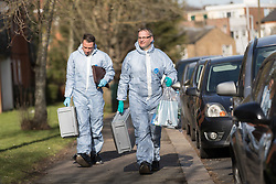 © Licensed to London News Pictures. 16/02/2018. London, UK. Forensic officers outside Garenne Court in Warren Road, Waltham Forest. A murder investigation has been launched after a man was found dead suffering from multiple injuries yesterday, 15th February. A 38 year old woman and a 63 year old man were arrested on suspicion of murder in the early hours of this morning.  Photo credit: Vickie Flores/LNP