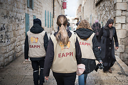 1 March 2020, Bethlehem, Palestine: Participants in the Ecumenical Accompaniment Programme in Palestine and Israel walk down a street towards the Evangelical Lutheran Christmas Church in Bethlehem. The EAPPI accompanies local communities living under occupation, which includes attending church on Sundays.