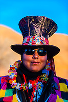 Young Navajo Woman wearing Mad Hatter hat at the Red Rock Balloon Rally, Red Rock State Park, Gallup, New Mexico USA.
