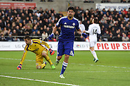 Diego Costa of Chelsea celebrates after he scores his teams 3rd goal while Swansea keeper Lukasz Fabianski is left dejected... Barclays Premier League match, Swansea city v Chelsea at the Liberty Stadium in Swansea, South Wales on Saturday 17th Jan 2015.<br /> pic by Andrew Orchard, Andrew Orchard sports photography.