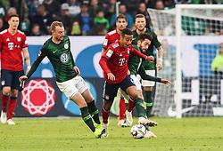 WOLFSBURG, Oct. 21, 2018  Bayern Munich's Thiago Alcantara (front C) breaks the defense from Wolfsburg's Maximilian Arnold (front L) and Yunus Malli during a German Bundesliga match between Wolfsburg and Bayern Munich, in Wolfsburg, Germany, on Oct. 20, 2018. Bayern Munich won 3-1. (Credit Image: © Xinhua via ZUMA Wire)