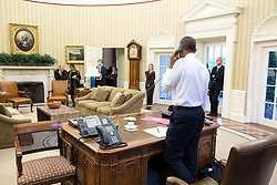 President Barack Obama talks on the phone with Secretary of State John Kerry regarding the Iran nuclear agreement in the Oval Office, July 13, 2015. Attending from left: Ben Rhodes, Deputy National Security Advisor for Strategic Communications, National Security Advisor Susan E. Rice, Jeffrey Prescott, Senior Director for Iran, Iraq, Syria, and the Gulf States, Avril Haines, Deputy National Security Advisor Counterterrorism and Chief of Staff Denis McDonough. (Official White House Photo by Pete Souza)<br /> <br /> This official White House photograph is being made available only for publication by news organizations and/or for personal use printing by the subject(s) of the photograph. The photograph may not be manipulated in any way and may not be used in commercial or political materials, advertisements, emails, products, promotions that in any way suggests approval or endorsement of the President, the First Family, or the White House.