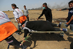 April 27, 2018 - Khan Younis, Gaza Strip - A wounded Palestinian woman is evacuated during clashes with Israeli security forces during tents protest demanding the right to return to their homeland, at the Israel-Gaza border, in Khan Younis in the southern Gaza Strip on April 27, 2018  (Credit Image: © Ashraf Amra/APA Images via ZUMA Wire)