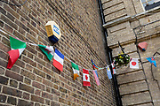 The flags of many nations hang untidily outside the Royal Oak pub, on 3rd October 2019, in Dartford, Kent, England. Voters in Dartford voted 64% in favour of Brexit during the 2016 referendum.
