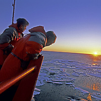 ARCTIC OCEAN. Passengers aboard Russian nuclear icebreaker Yamal watch sunset over Arctic Ocean, en route to North Pole. (East Siberian Sea)