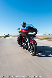 Jim Entenman of J and L Harley-Davidson and a member of Sioux Falls HOG riding his 2017 FLTRX for the USS South Dakota submarine flag relay across South Dakota on the first day from Sturgis to Aberdeen. SD. USA. Saturday October 7, 2017. Photography ©2017 Michael Lichter.