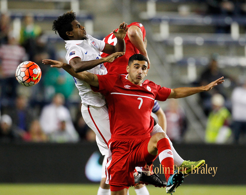 USA midfielder Gedion Zelaem (16) collides with Canada midfielders Mauro Eustaquio (7) and Sam Piette (14) as they go up for a header in the first half of a CONCACAF men's Olympic qualifying soccer match, Thursday, Oct. 1, 2015, in Kansas City, Kan. (AP Photo/Colin E. Braley)