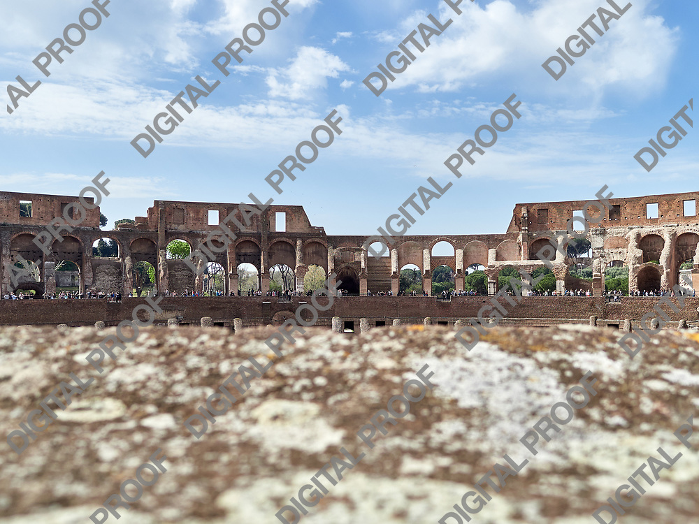 Inside low angle view of the Colosseum with tourists during the day