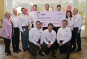 """The KFC Leadership Team with the check given to representatives of Susan G. Komen for the Cure® on Monday, Aug. 23, 2010 in Louisville, Ky. The more than $4.2 million donation is a result of the chain's """"Buckets for the Cure(TM)"""" campaign and is the single largest donation in the history of Susan G. Komen for the Cure. (Photo by Brian Bohannon)."""