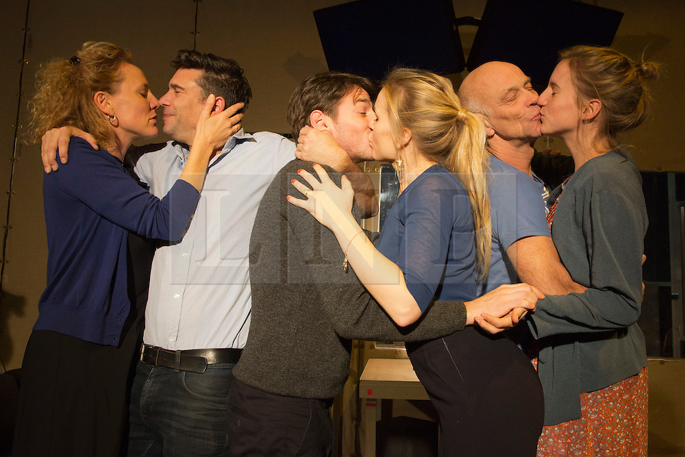 © Licensed to London News Pictures. 14/11/2013. London, England. Pictured: all couples engage in a group-kiss. Toneelgroep Amsterdam perform Scenes from a Marriage by Ingmar Bergman at the Barbican Theatre, London, 14-17 November 2013. With Alwin Pulinckx, Roeland Fernhout and Hugo Koolschijn as Johan and Suzanne Grotenhuis, Hadewych Minis and Janni Goslinga as Marianne; directed by Ivo van Hove. Photo credit: Bettina Strenske/LNP