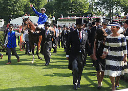 Jockey James Doyle on Barney Roy celebrates in the winners encloser after winning the St James's Palace Stakes during day one of Royal Ascot at Ascot Racecourse.