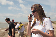 March 31, 2015,  Five years after the BP oil spill, National Wildlife Federation spokesperson,Emily Guidry Schatzel, smells a BP tar ball found on East Grande Terre, a barrier island in Plaquemines Parish that was hit hard by the BP oil spill in 2010.