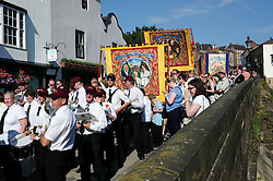 "© Licensed to London News Pictures. 13/07/2013<br /> <br /> Durham City, England, United Kingdom<br /> <br /> A colliery band waits to march during the Durham Miners Gala.<br /> <br /> The Durham Miners' Gala is a large annual gathering held each year in the city of Durham. It is associated with the coal mining heritage of the Durham Coalfield, which stretched throughout the traditional County of Durham, and also gives voice to miners' trade unionism. <br /> <br /> Locally called ""The Big Meeting"" or ""Durham Big Meeting"" it consists of banners, each typically accompanied by a brass band, which are marched to the old Racecourse, where political speeches are delivered. In the afternoon a Miners' service is held in Durham Cathedral <br /> <br /> Photo credit : Ian Forsyth/LNP"