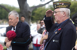 May 29, 2017 - Fountain Valley, CA, USA - U.S Representative Dana Rohrabacher, left, removes his hat as Fountain Valley mayor John Collins, right, salutes the U.S. flag as it is raised by Fountain Valley Police Explorers during a Memorial Day Ceremony on Monday, May 29, 2017. (Credit Image: © Drew A. Kelley/The Orange County Register via ZUMA Wire)